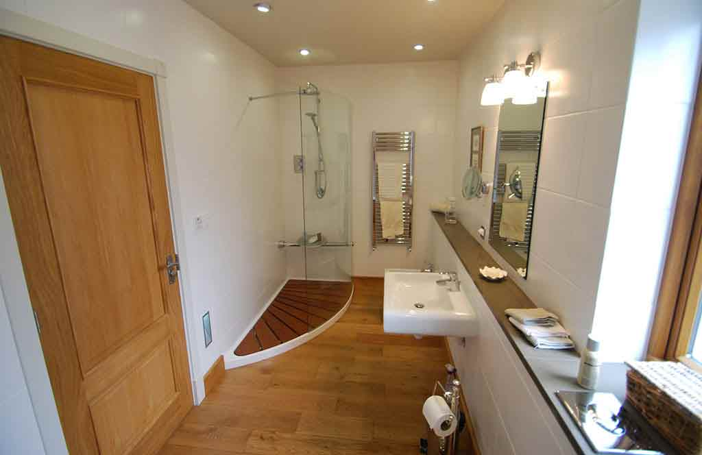 Click to enlarge image 1-Eco-friendly-bathroom-bright-white-walls-wooden-floor.jpg